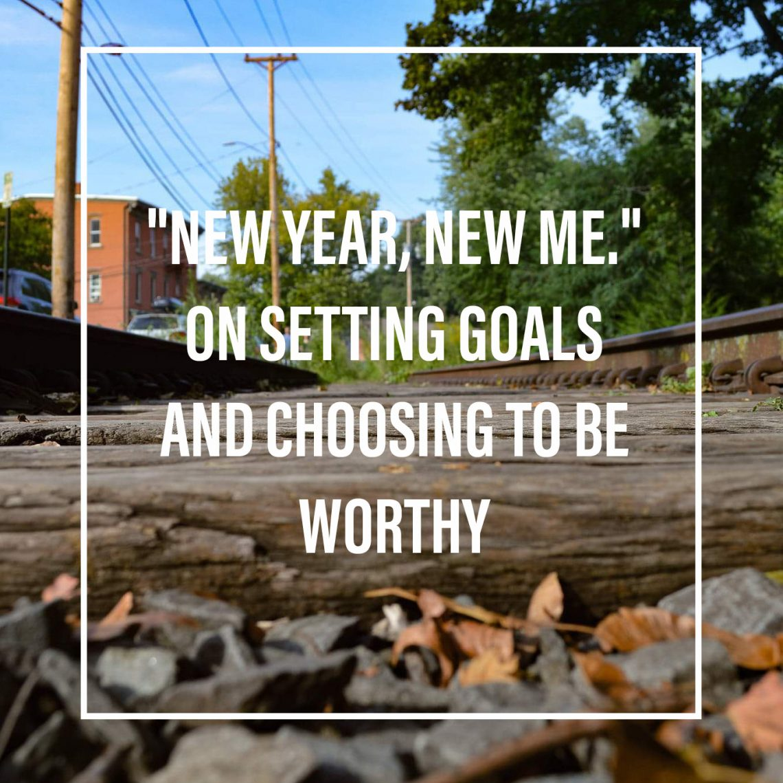"Train tracks with the words ""New Year, New me. On setting Goals and choosing to be worthy"""