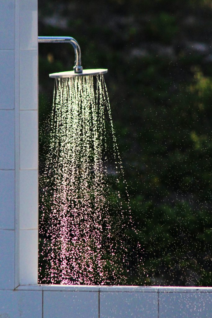 rainfall shower head with water pouring out