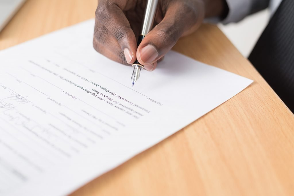 A document on a table being signed