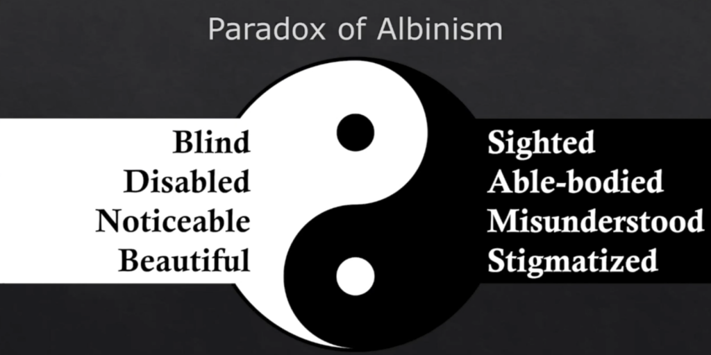 The paradox of albinism graphic featuring a yin and yang